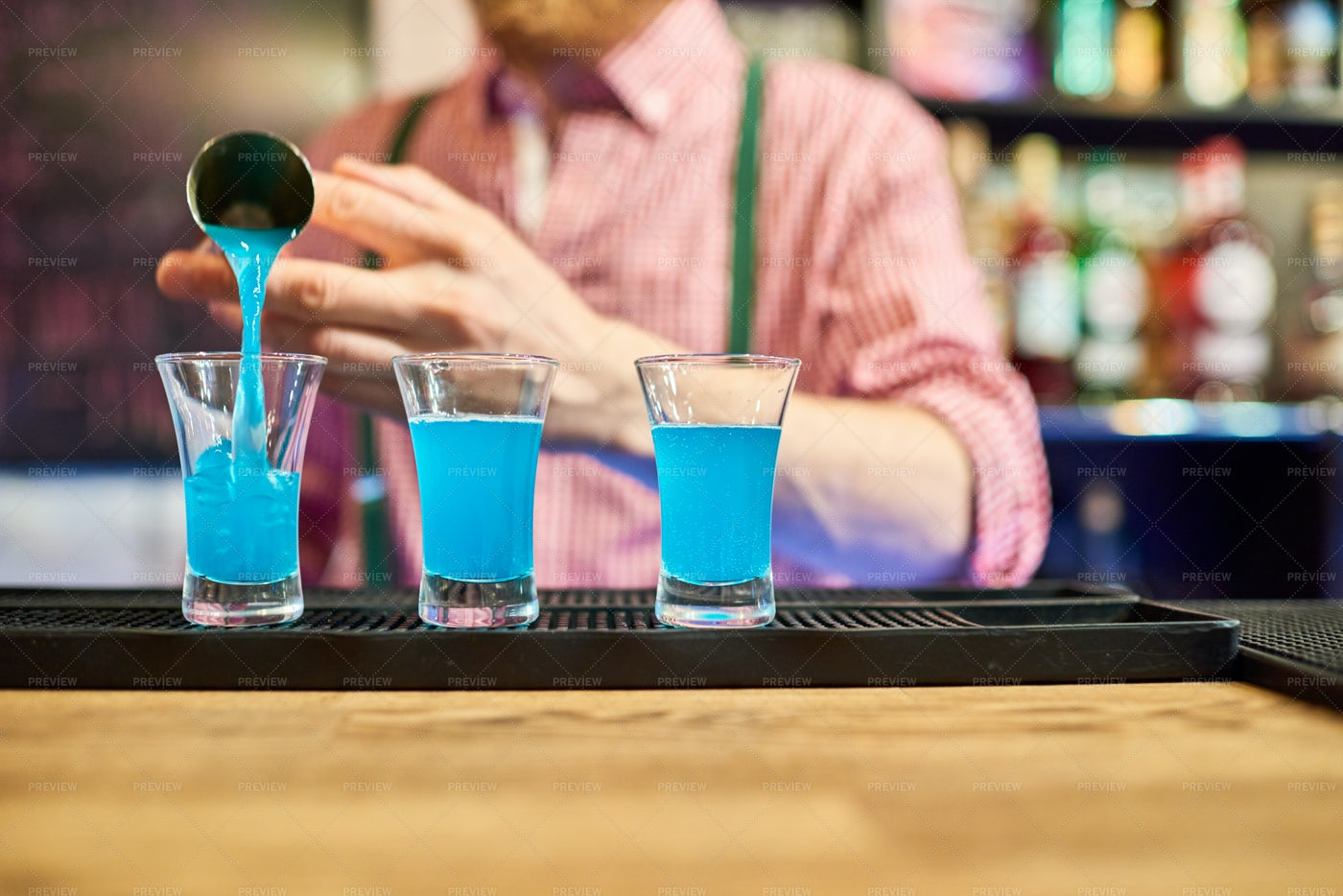 Bartender  Pouring Vodka Shots At...: Stock Photos