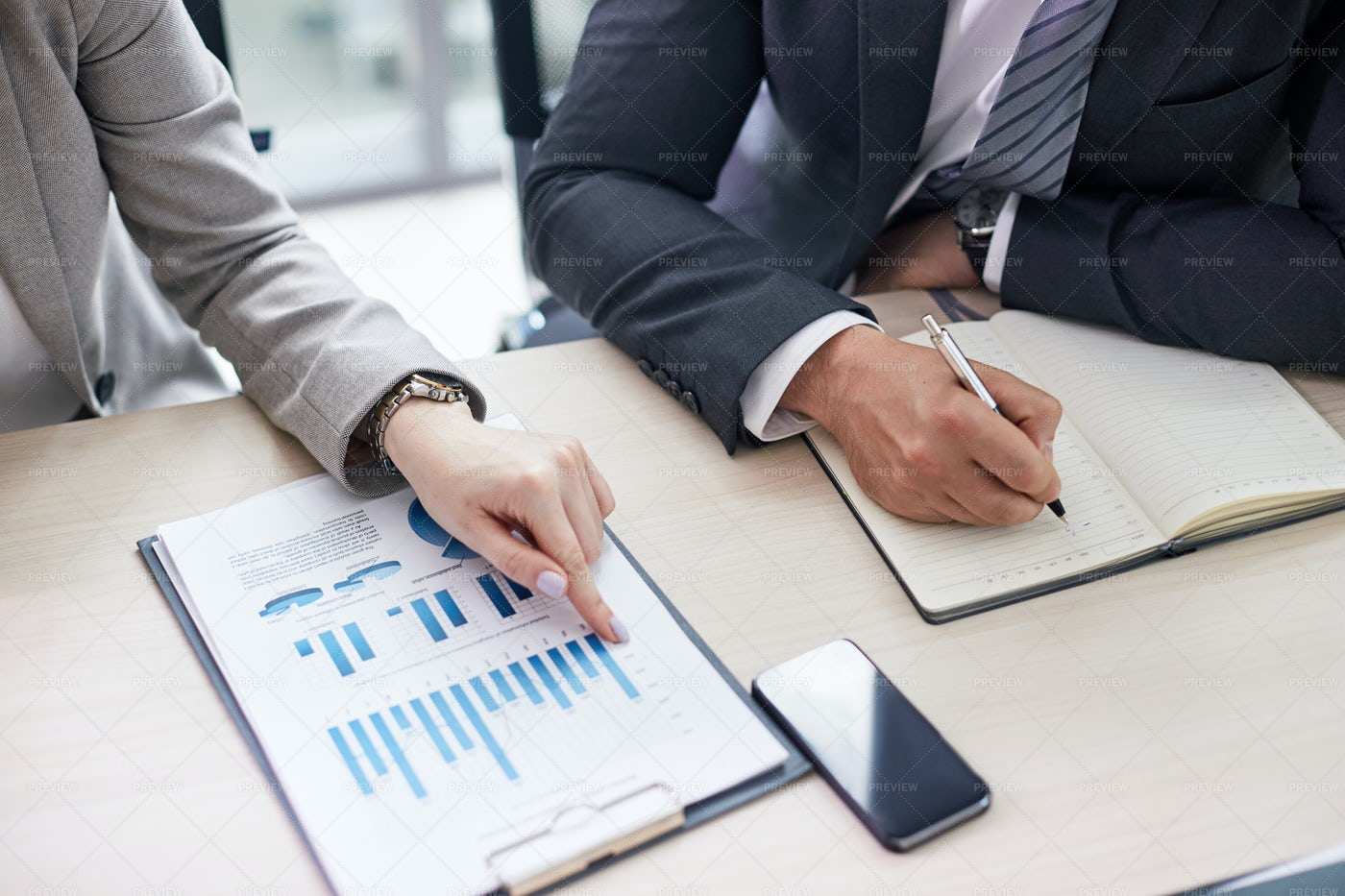 Studying Financial Figures: Stock Photos