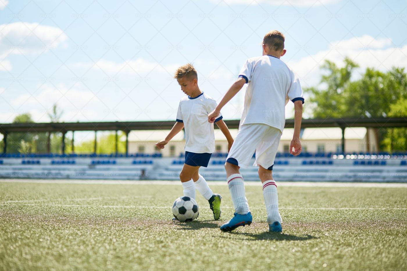 Boys Playing  Football Outdoors: Stock Photos