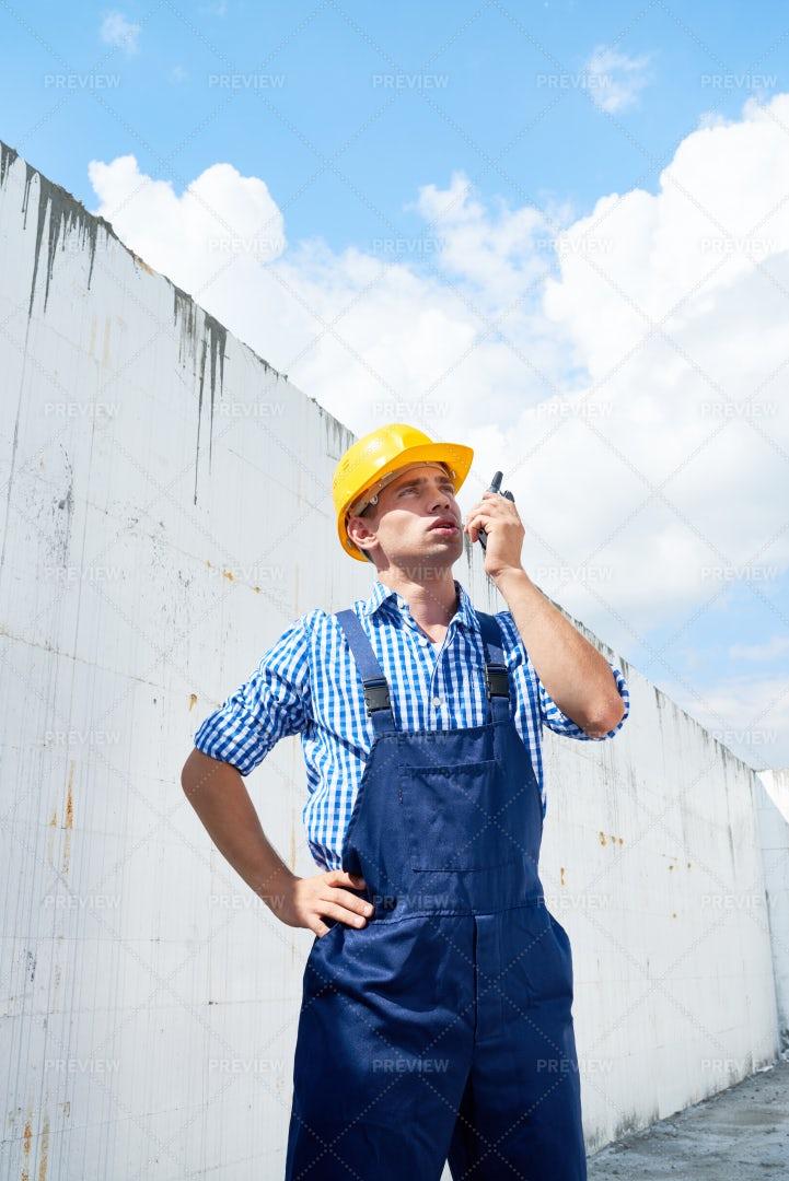Construction Foreman Using Portable...: Stock Photos
