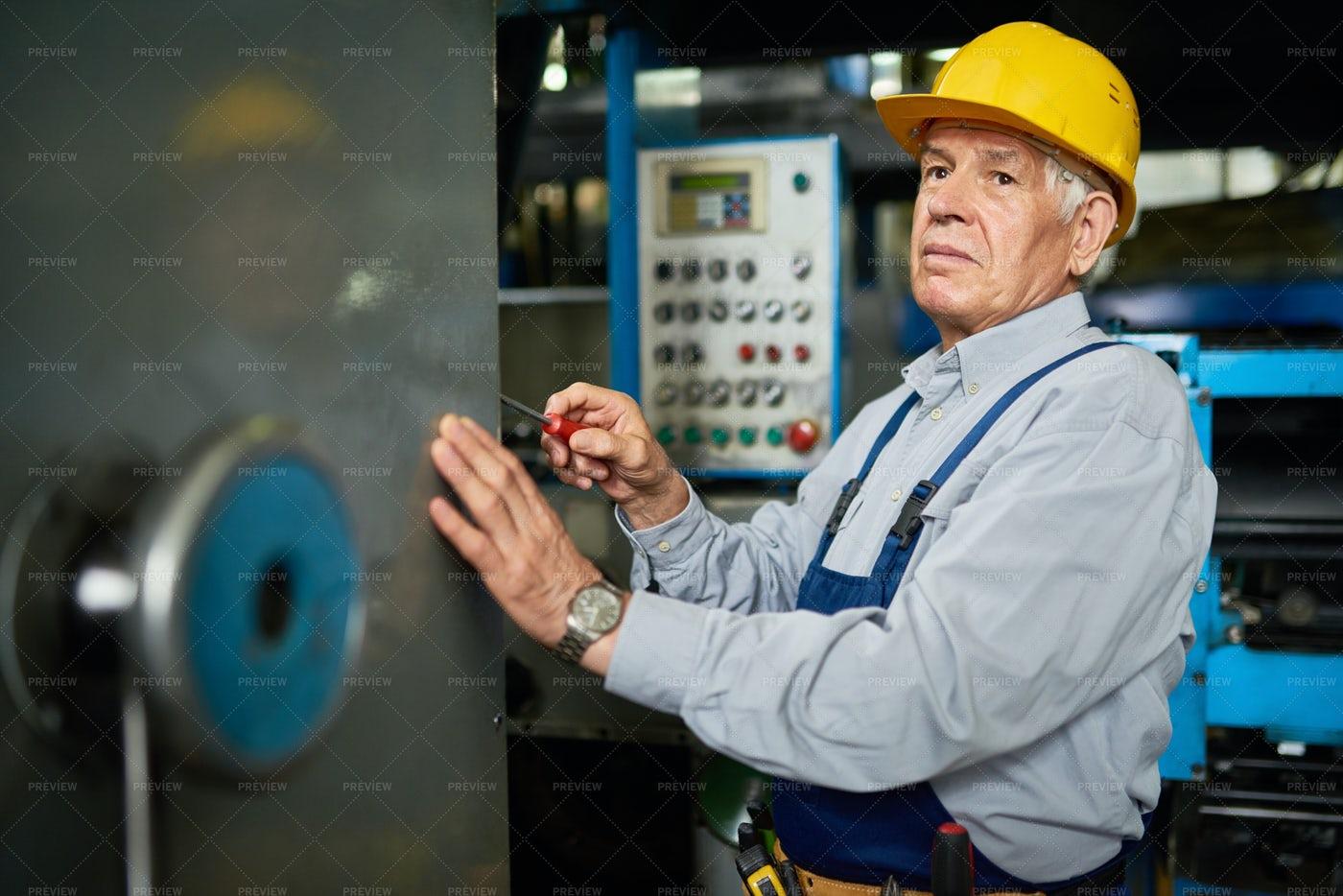 Senior Mechanic Repairing Machines: Stock Photos