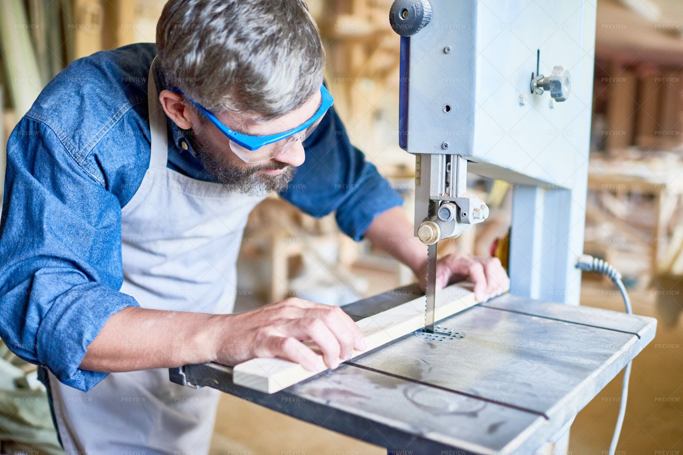 Carpenter Cutting Wood In Joinery: Stock Photos