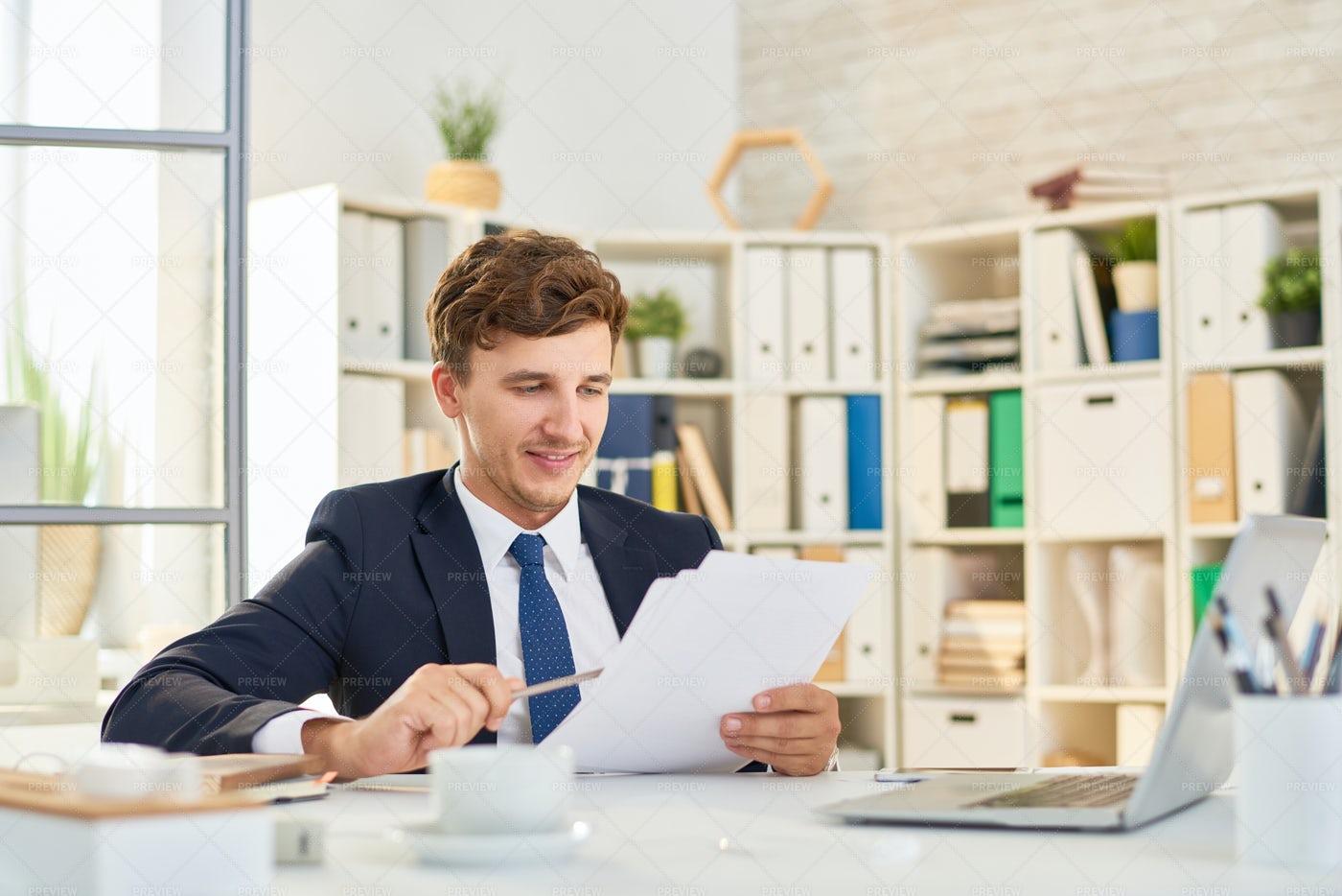 Successful Businessman Reading...: Stock Photos