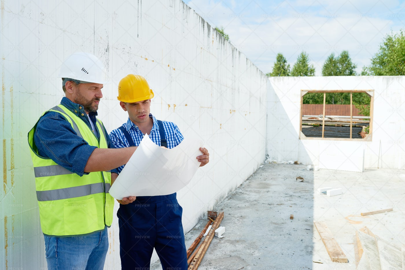 Construction Worker Discussing...: Stock Photos