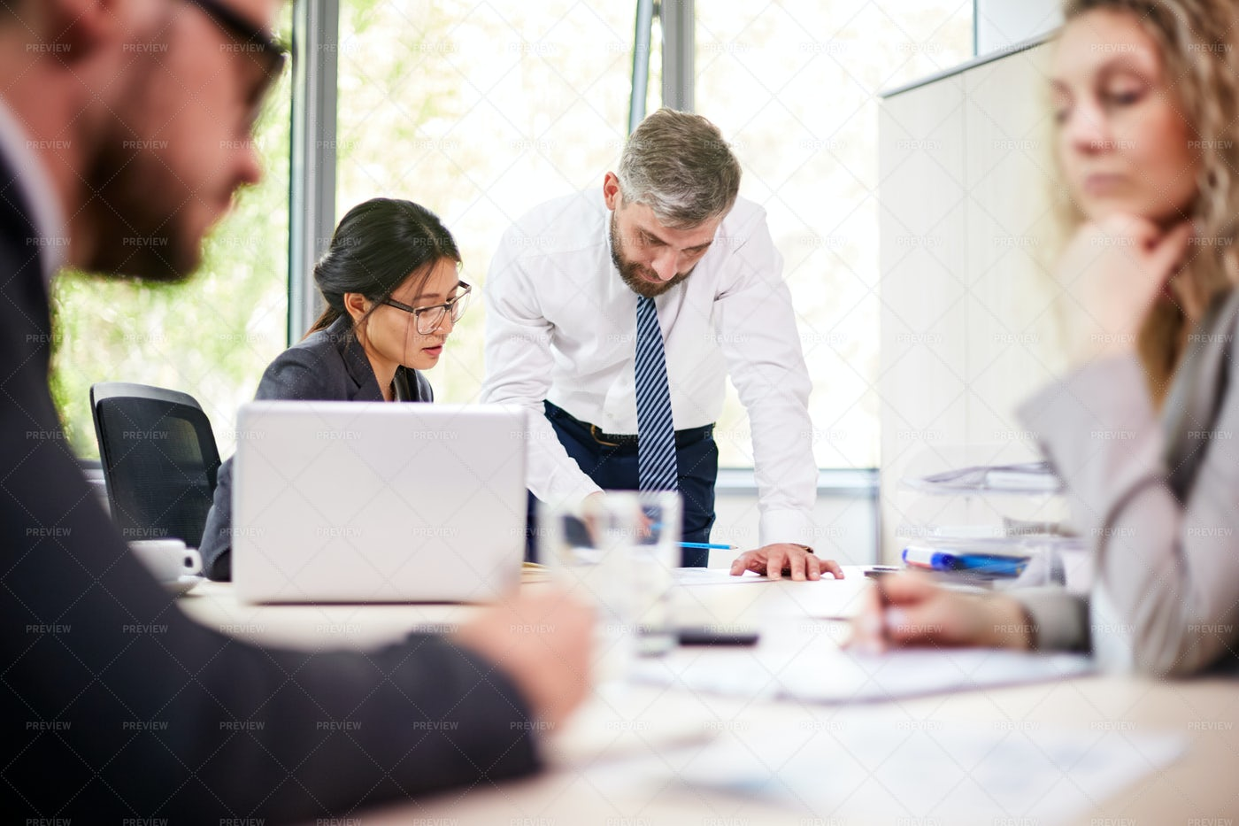 Discussing Project With Colleagues: Stock Photos