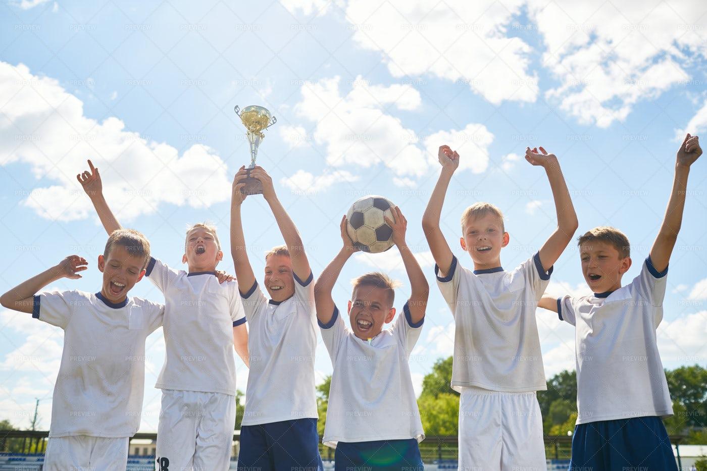 Boys Football Team Winning...: Stock Photos