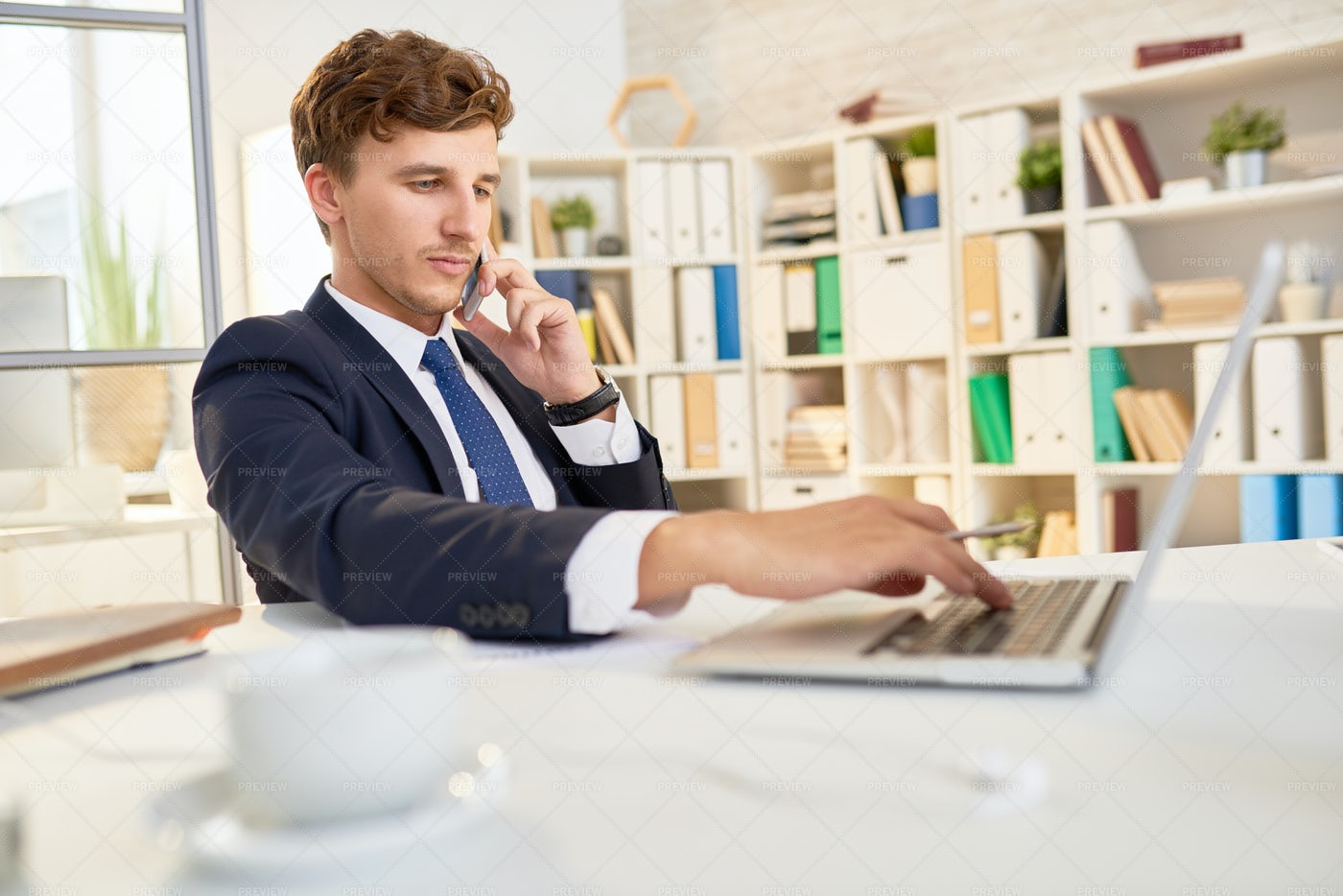 Confident Businessman Working In...: Stock Photos