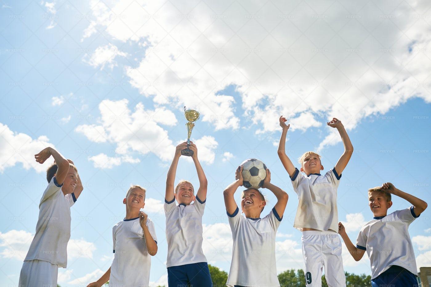 Junior Football Team Celebrating...: Stock Photos
