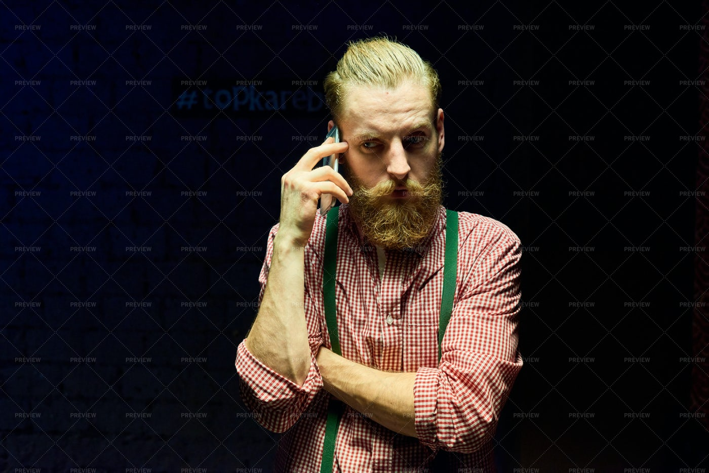 Hipster Speaking By Phone Against...: Stock Photos