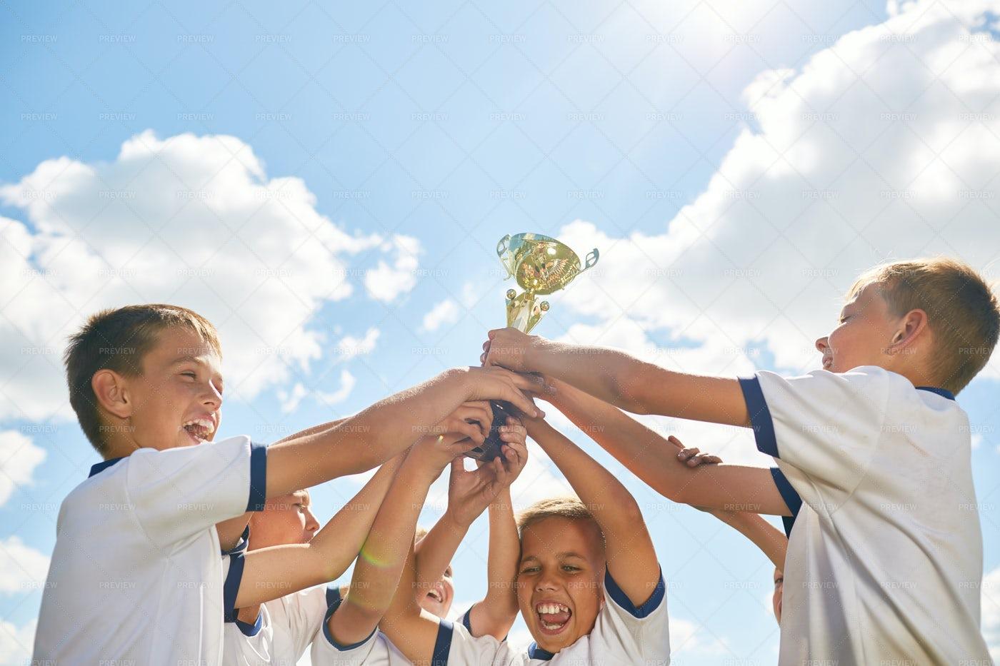 Boys Sports Team Holding Trophy: Stock Photos