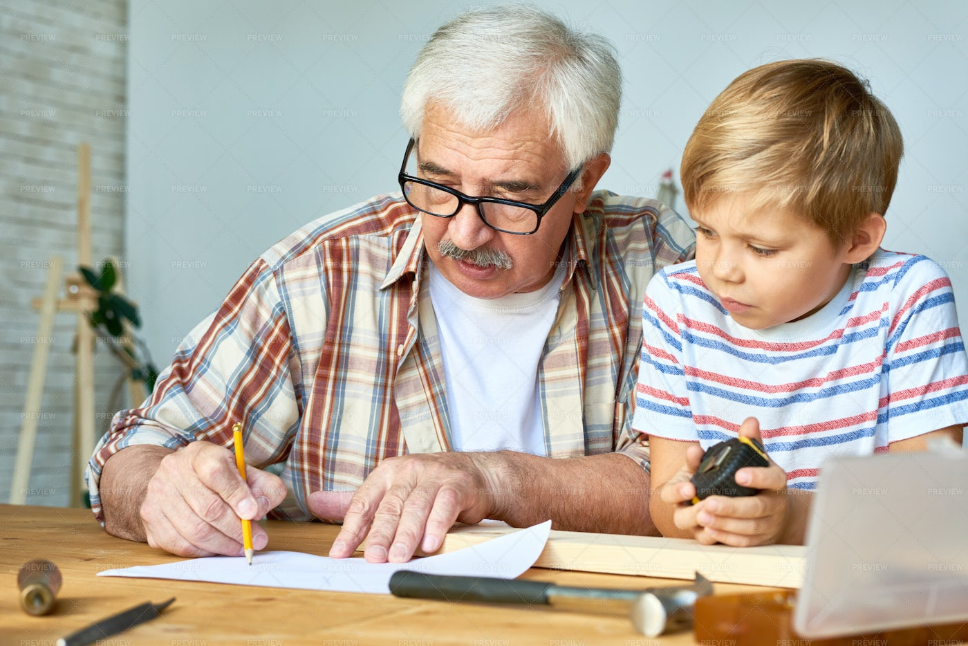 Grandfather And Little Boy Working...: Stock Photos