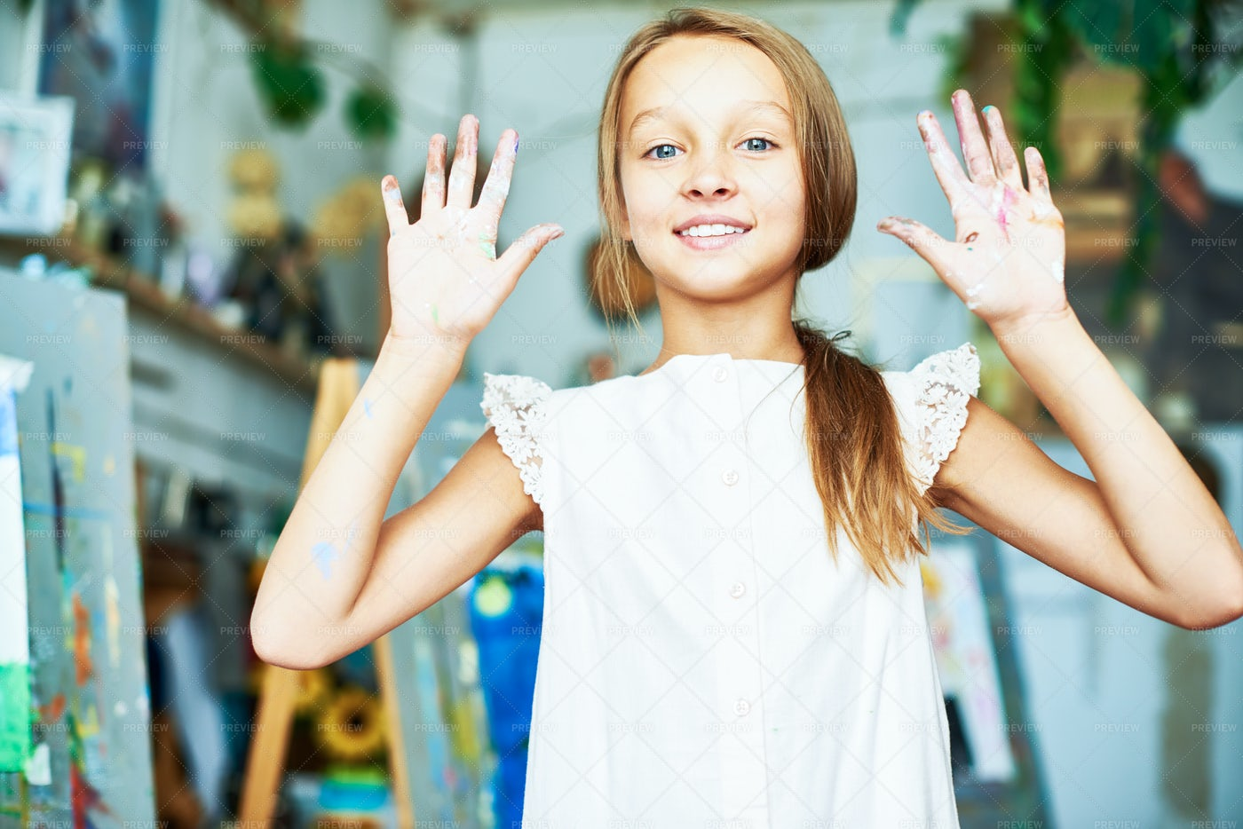 Happy Young Painter In Art Class: Stock Photos