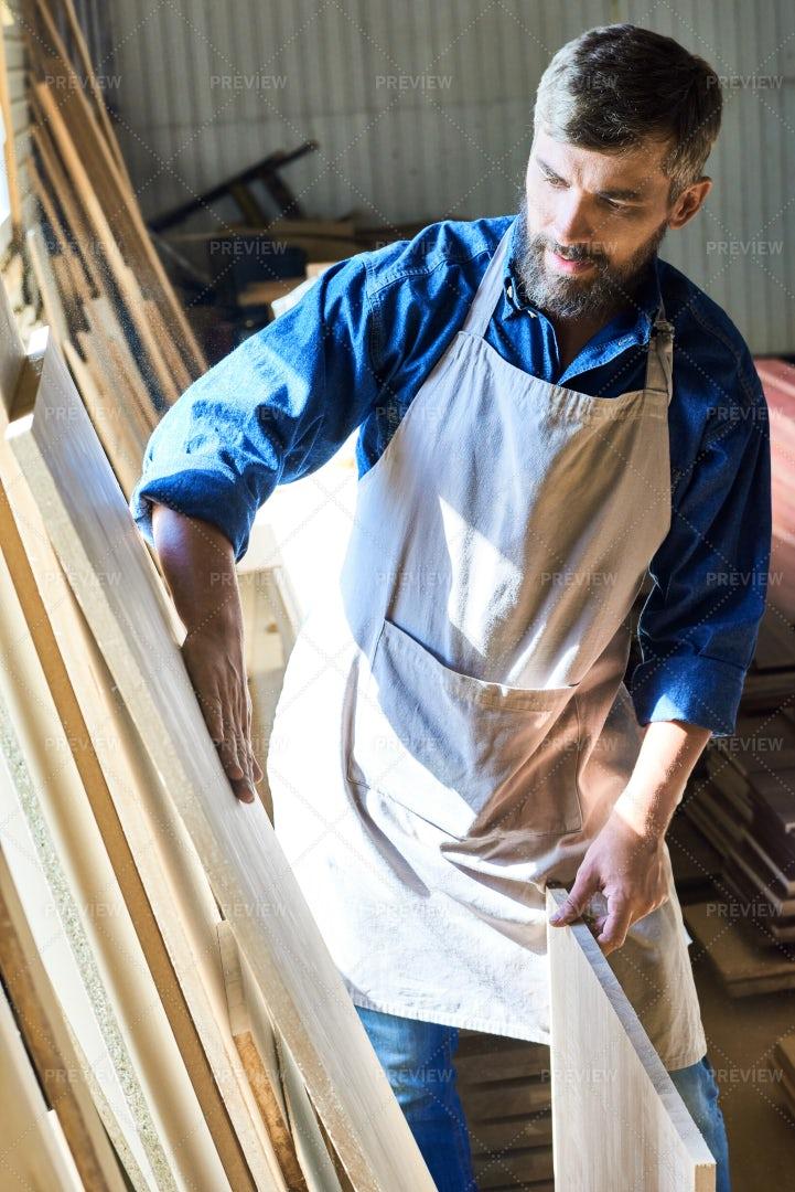 Skilled Carpenter Choosing Wooden...: Stock Photos