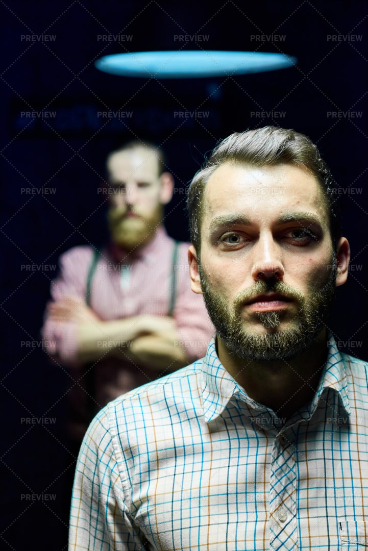 Two Men Posing In Dark: Stock Photos