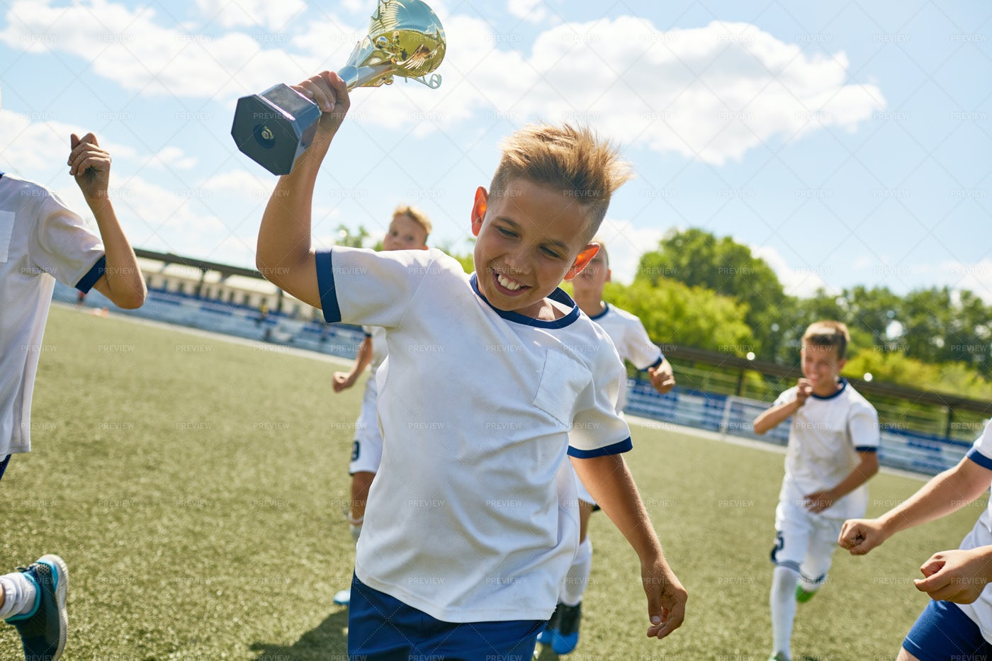 Boy Holding Trophy Cup: Stock Photos