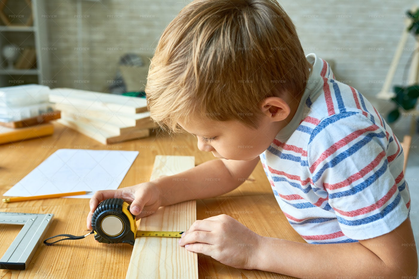 Cute Boy Working With Wood: Stock Photos