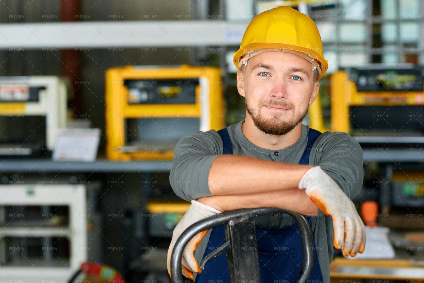Young Workman Smiling At Camera: Stock Photos