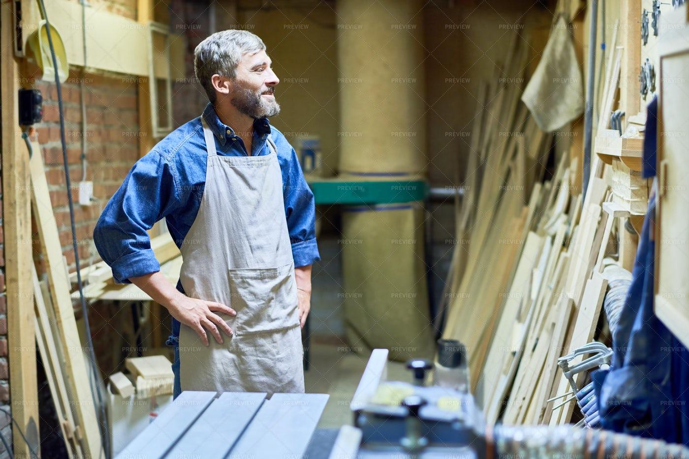 Bearded Carpenter In Storage Room: Stock Photos