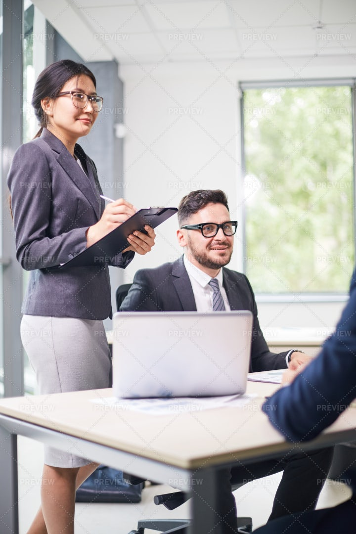 Discussing Cooperation Details With...: Stock Photos