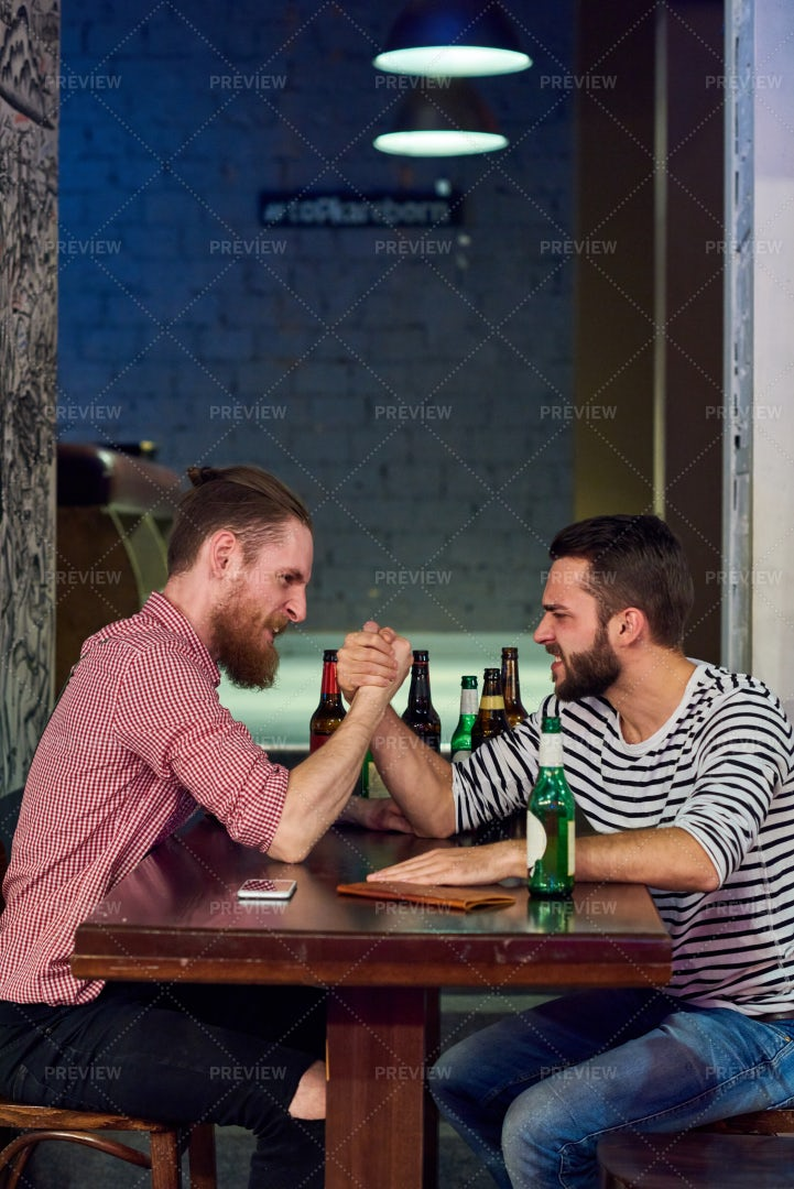 Two Men Armwrestling In Bar: Stock Photos