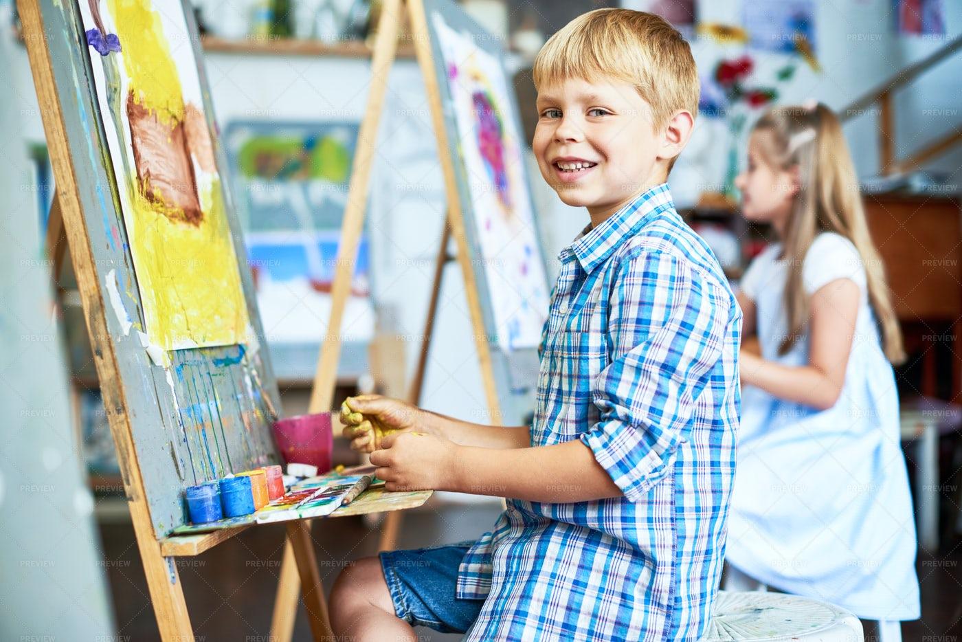 Smiling Little Boy In Art Class: Stock Photos