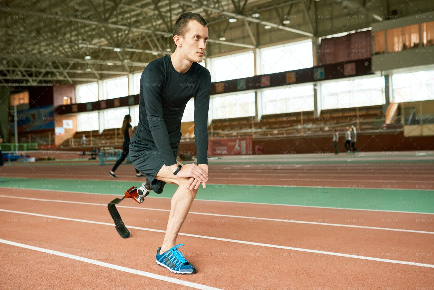 Handicapped Sportsman Stretching: Stock Photos
