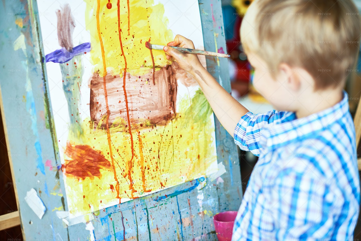Little Boy Painting In Art Therapy: Stock Photos