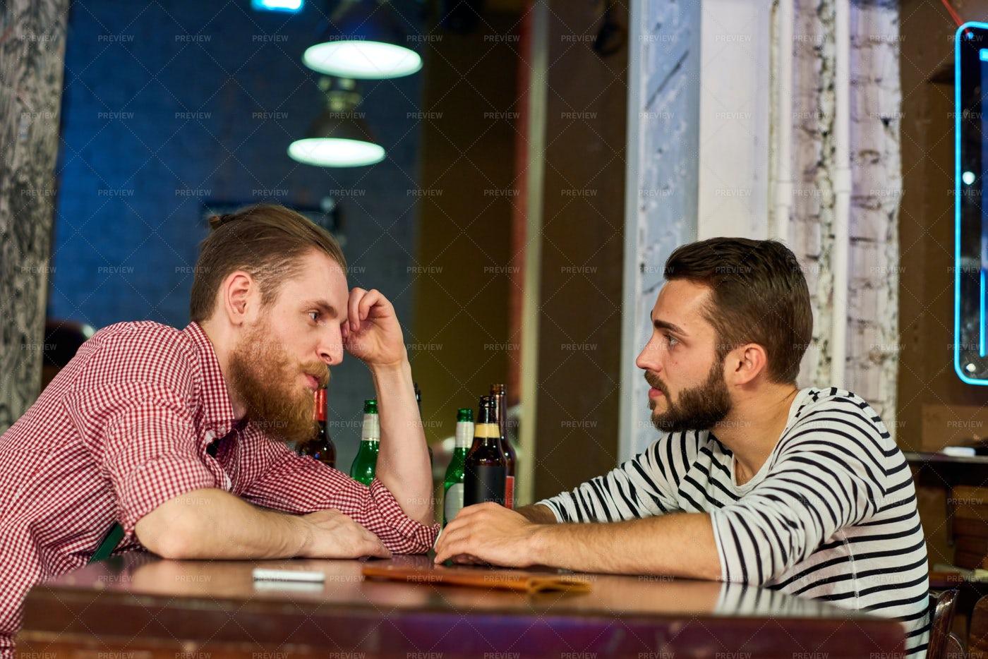 Two Buddies Talking In Bar: Stock Photos