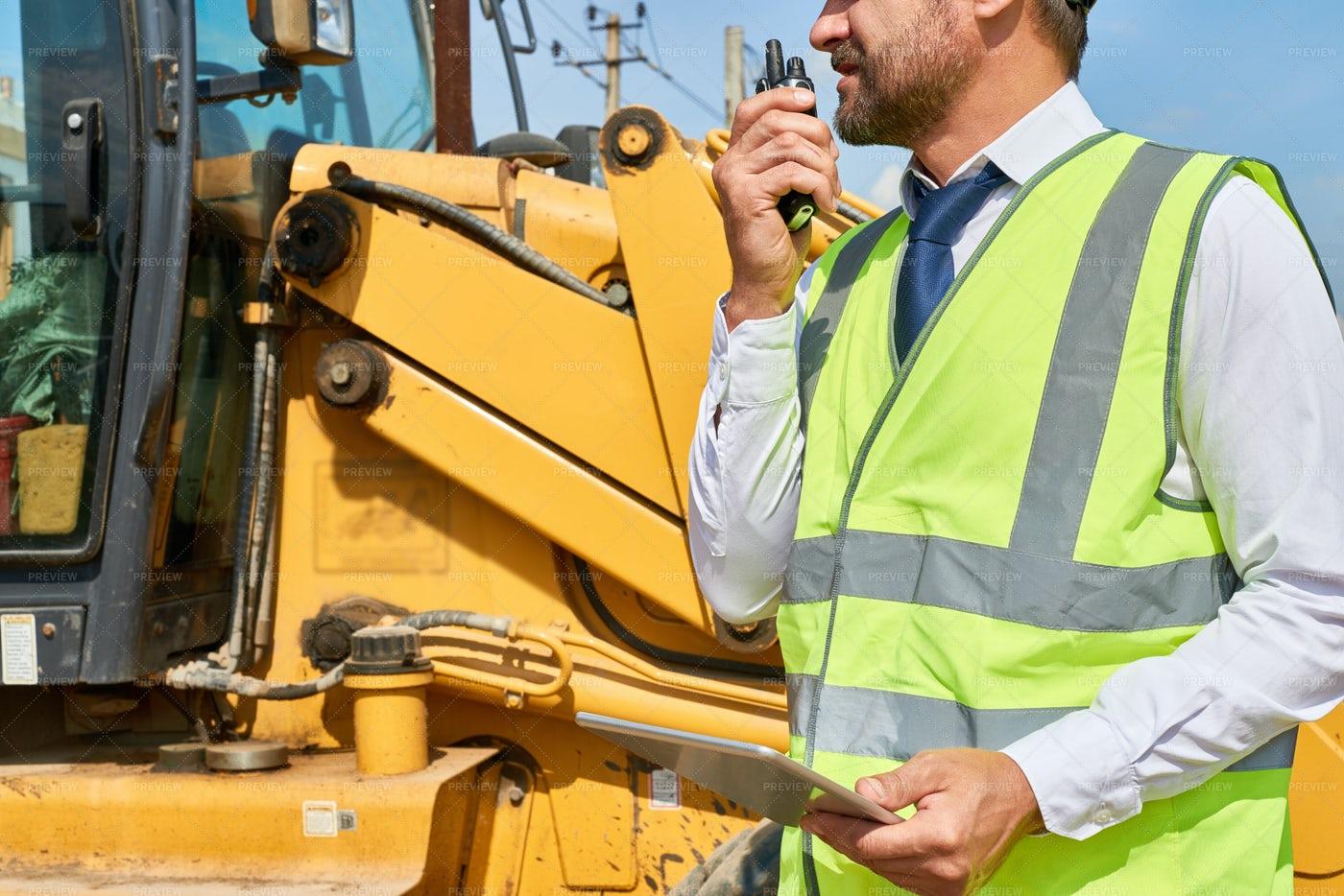 Construction Foreman Giving...: Stock Photos