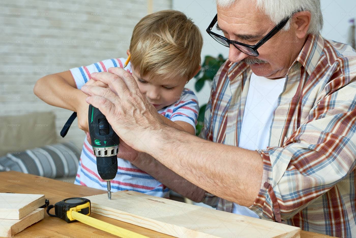 Cute Little Boy Drilling Wood With ...: Stock Photos