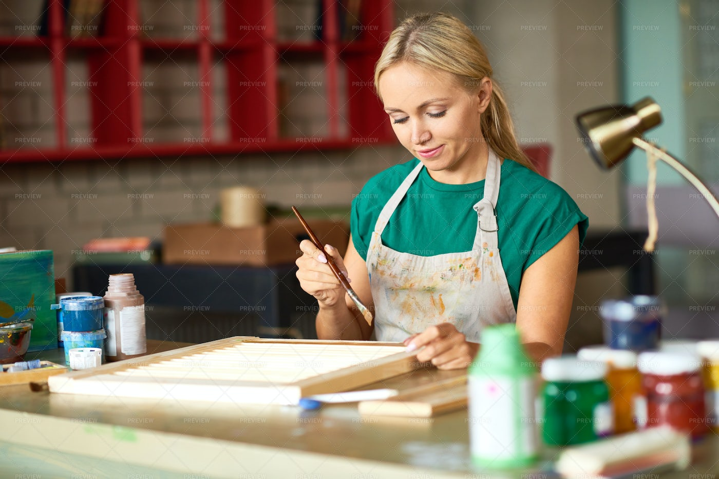 Young Woman Painting DIY Project: Stock Photos