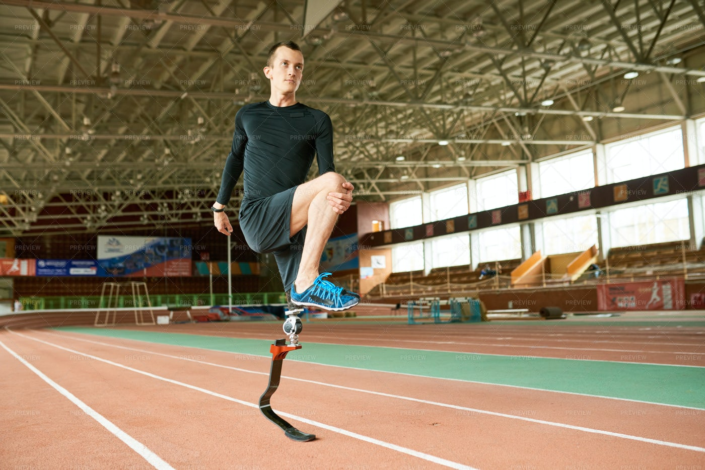 Handicapped Athlete Warming Up: Stock Photos
