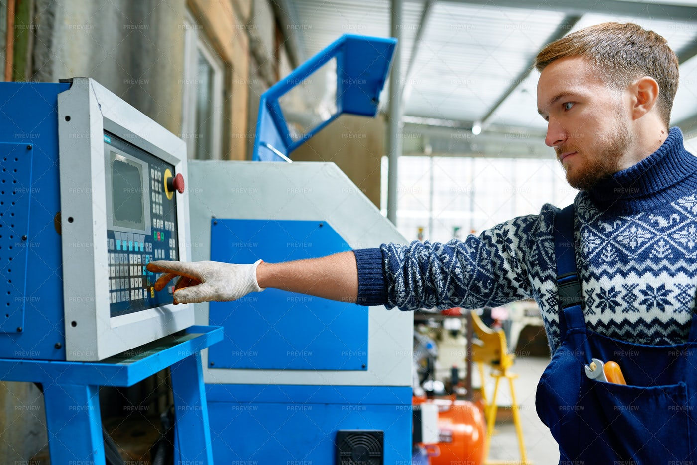 Modern Machine Operator At Factory: Stock Photos