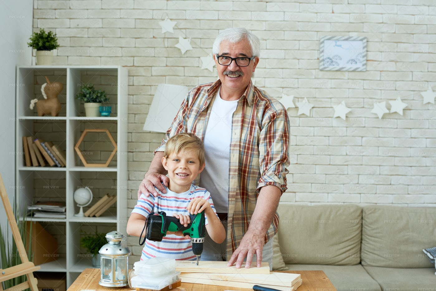 Happy Grandfather Posing With...: Stock Photos