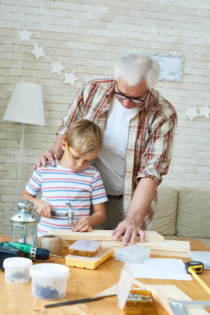 Grandfather Teaching Grandson...: Stock Photos