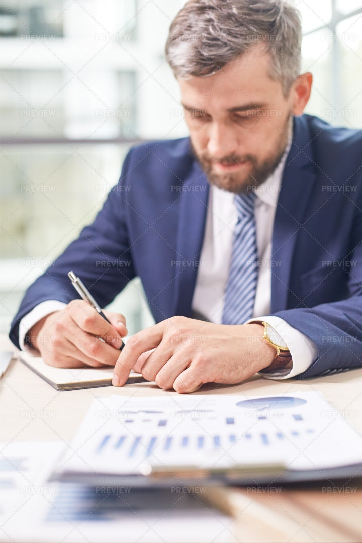 Bearded Manager Wrapped Up In Work: Stock Photos