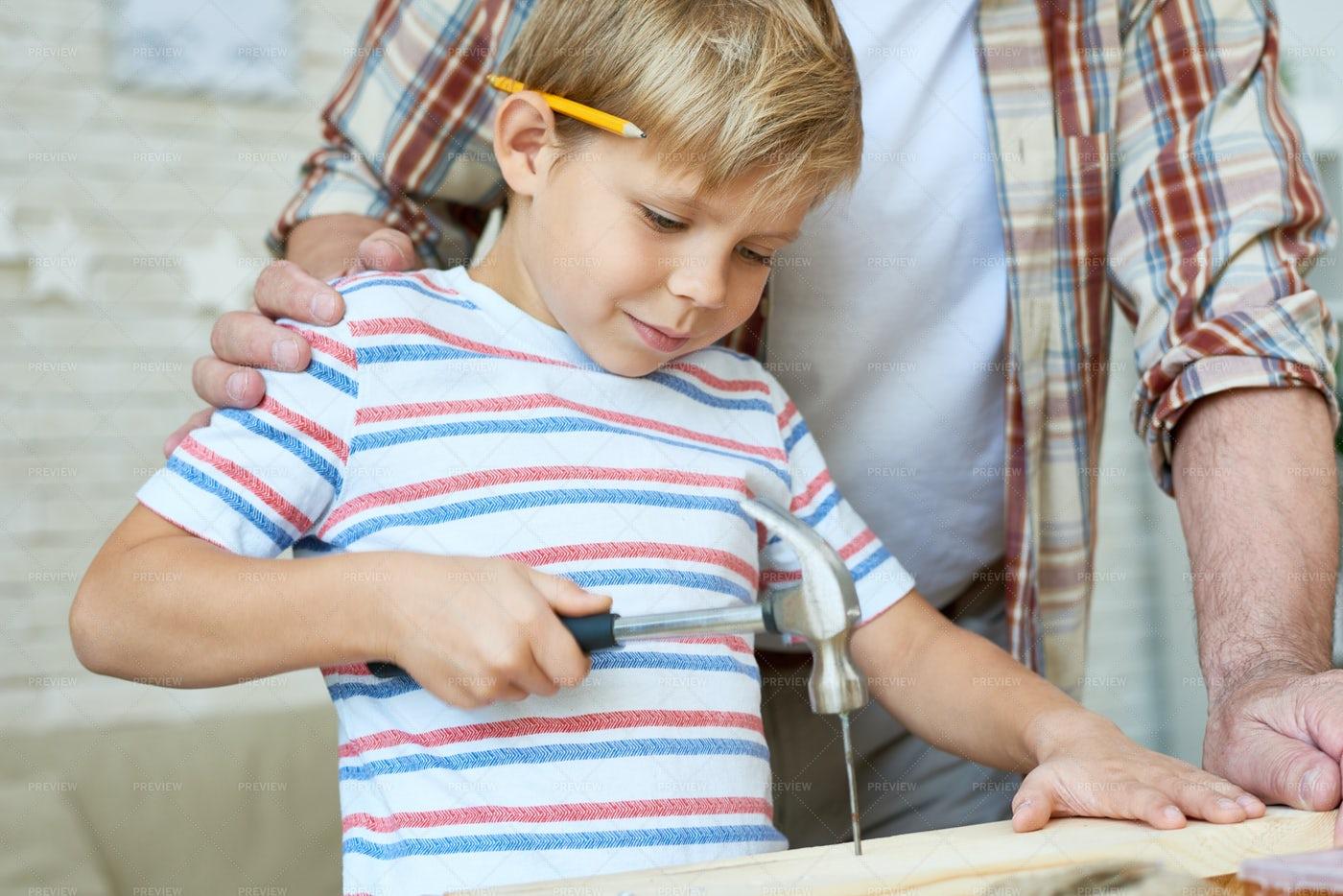 Little Boy Hammering Nails: Stock Photos