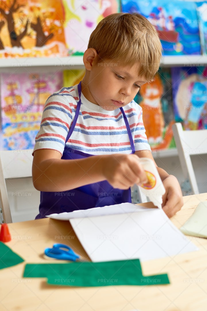 Little Boy Crafting In Class: Stock Photos