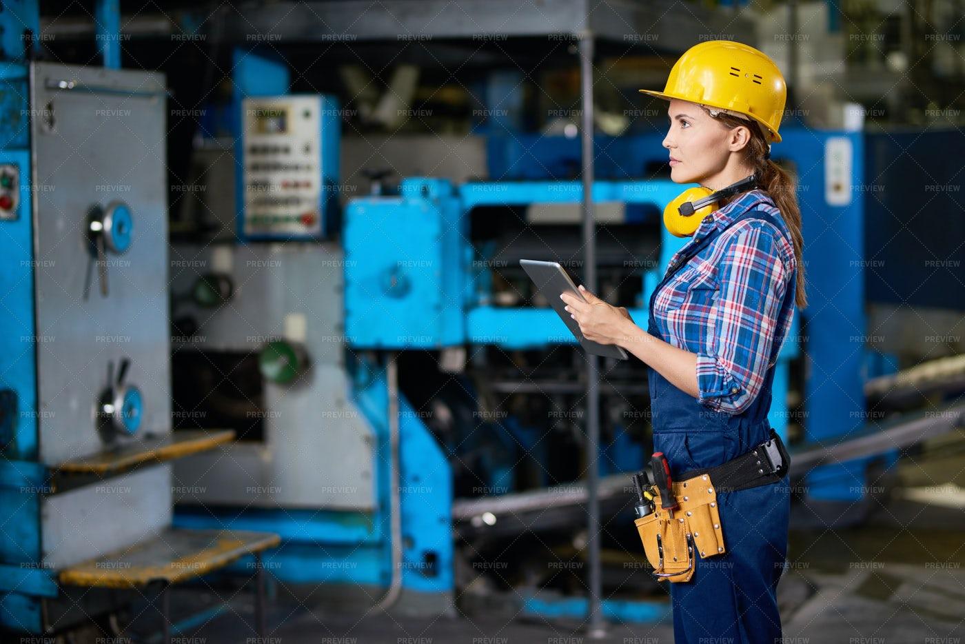 Female Technician Checking Machines...: Stock Photos