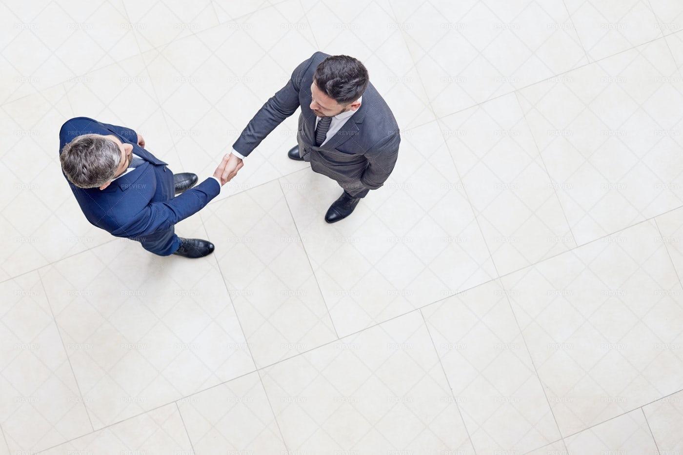 Confident Entrepreneurs Shaking...: Stock Photos