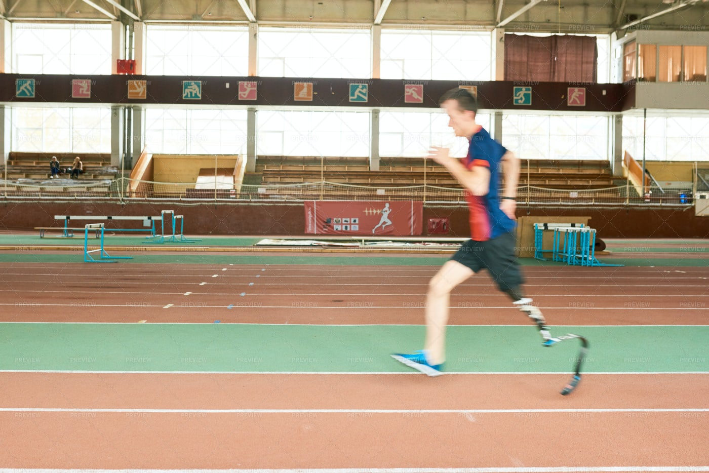 Handicapped Runner On Track: Stock Photos