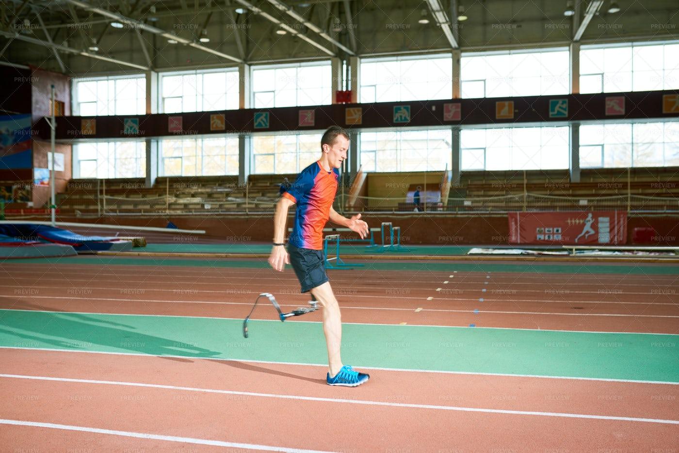 Handicapped Sportsman Running On...: Stock Photos