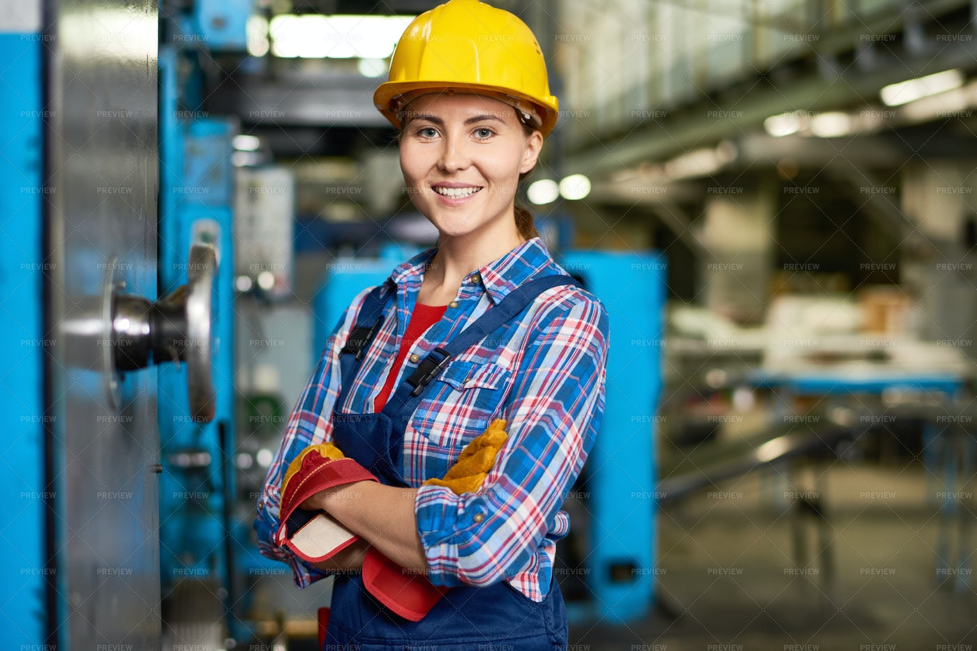 Happy Young Woman Working At...: Stock Photos