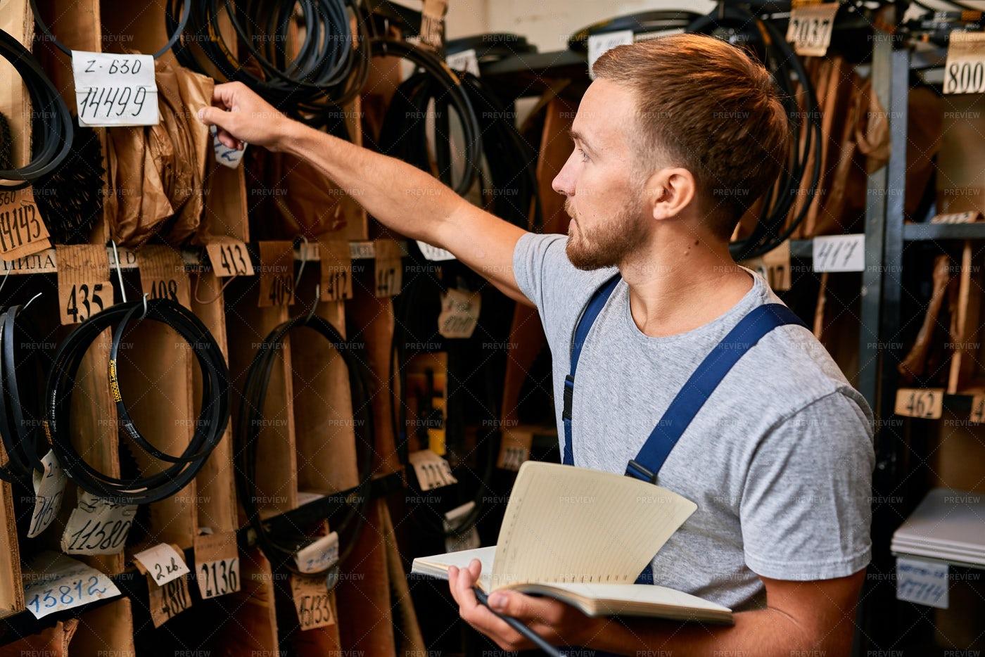 Man Doing Stock Inventory: Stock Photos