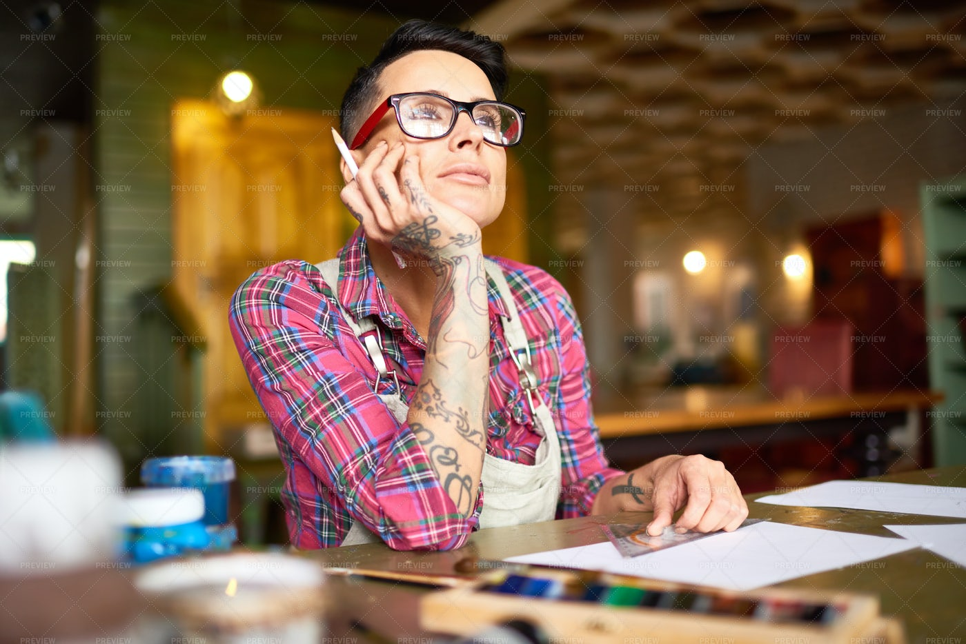 Tattooed Woman Daydreaming In Art...: Stock Photos