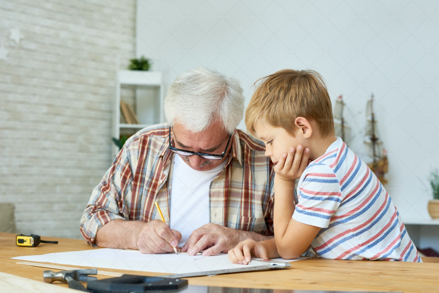 Grandfather And Little Boy Drawing...: Stock Photos