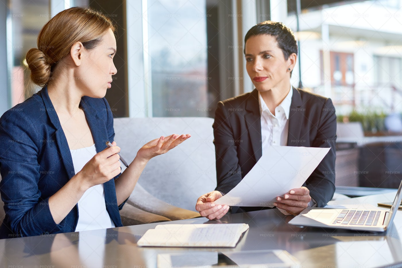 Financial Managers Focused On Work: Stock Photos