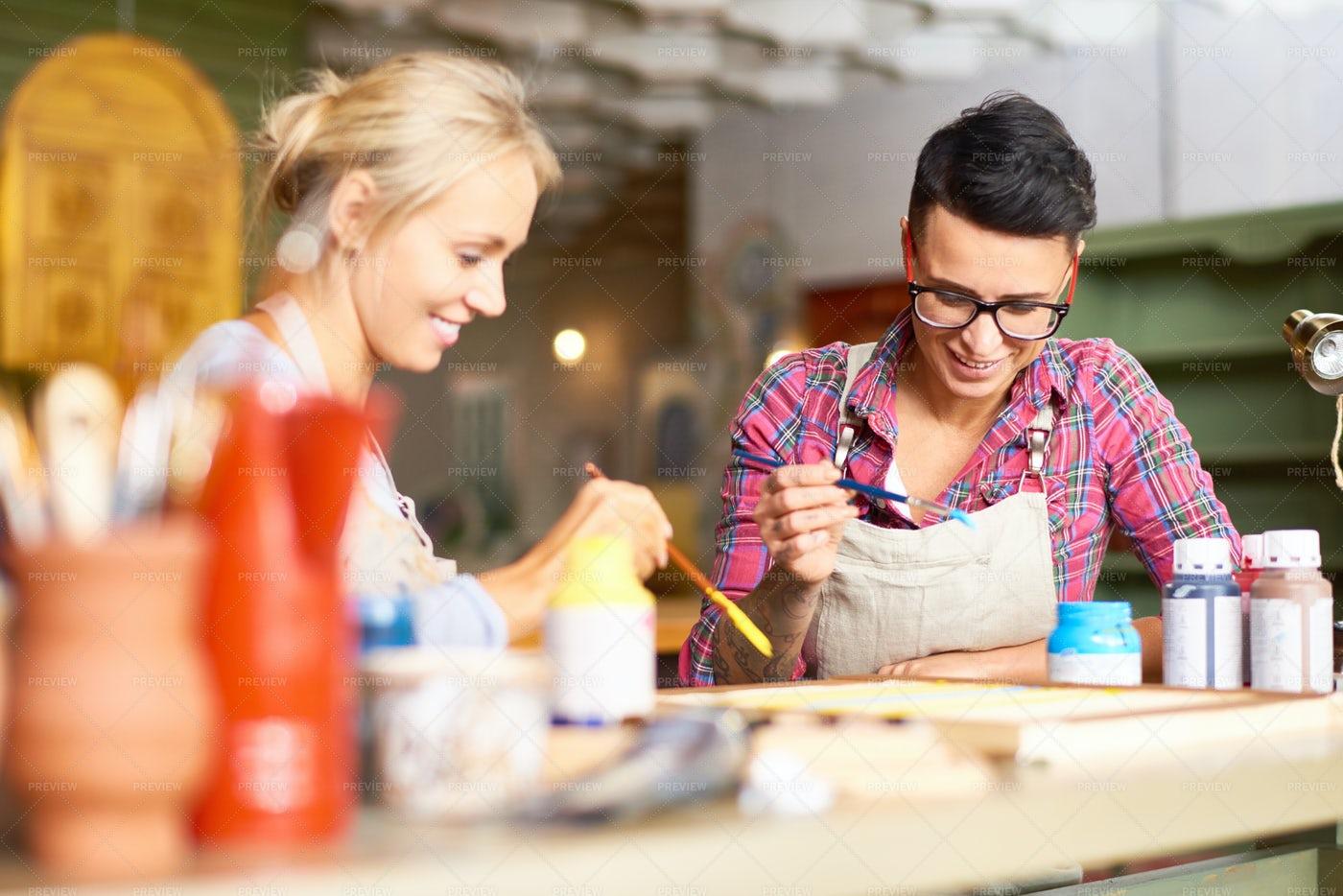Creative Young Women Painting...: Stock Photos