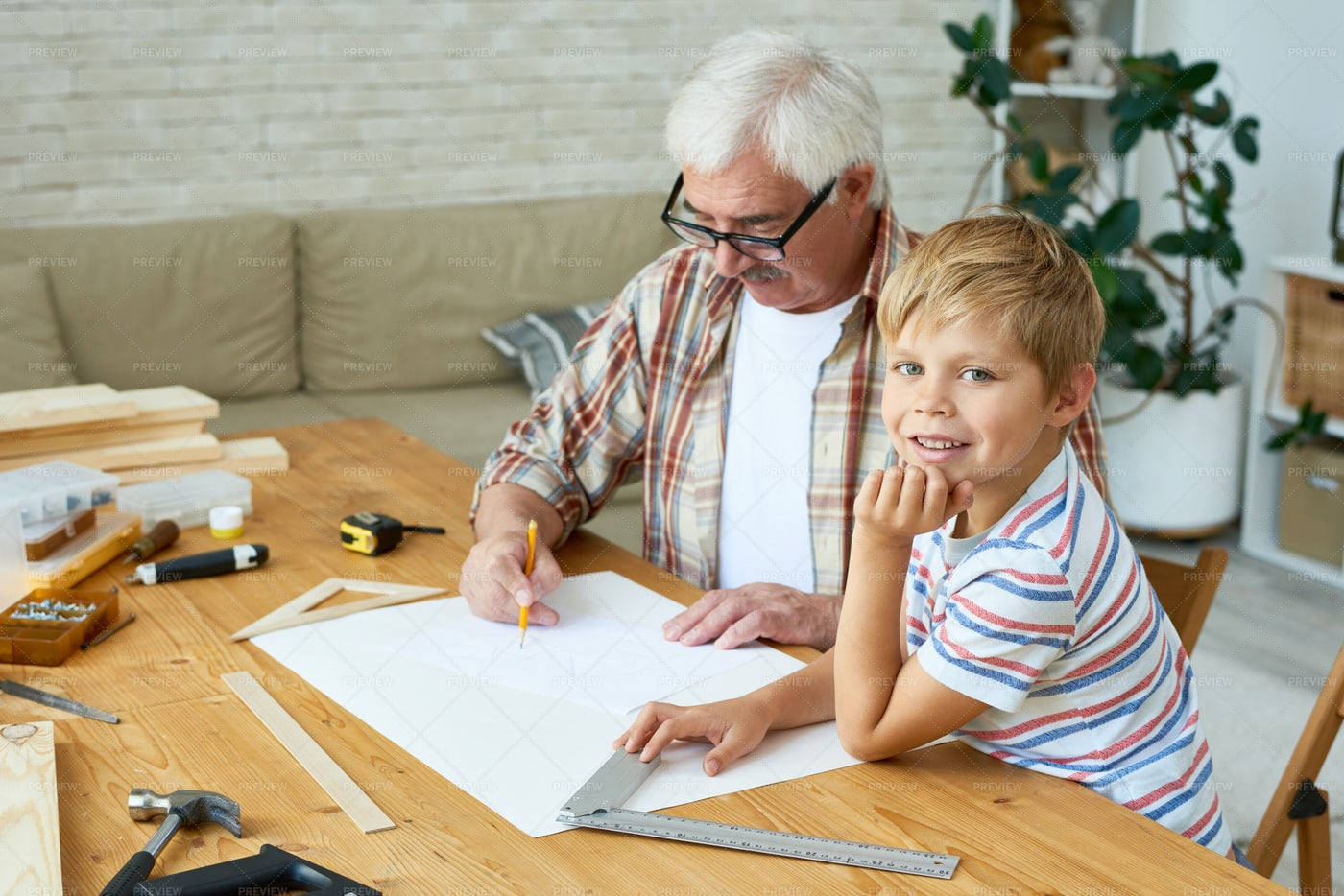 Little Boy Helping Grandpa Make...: Stock Photos