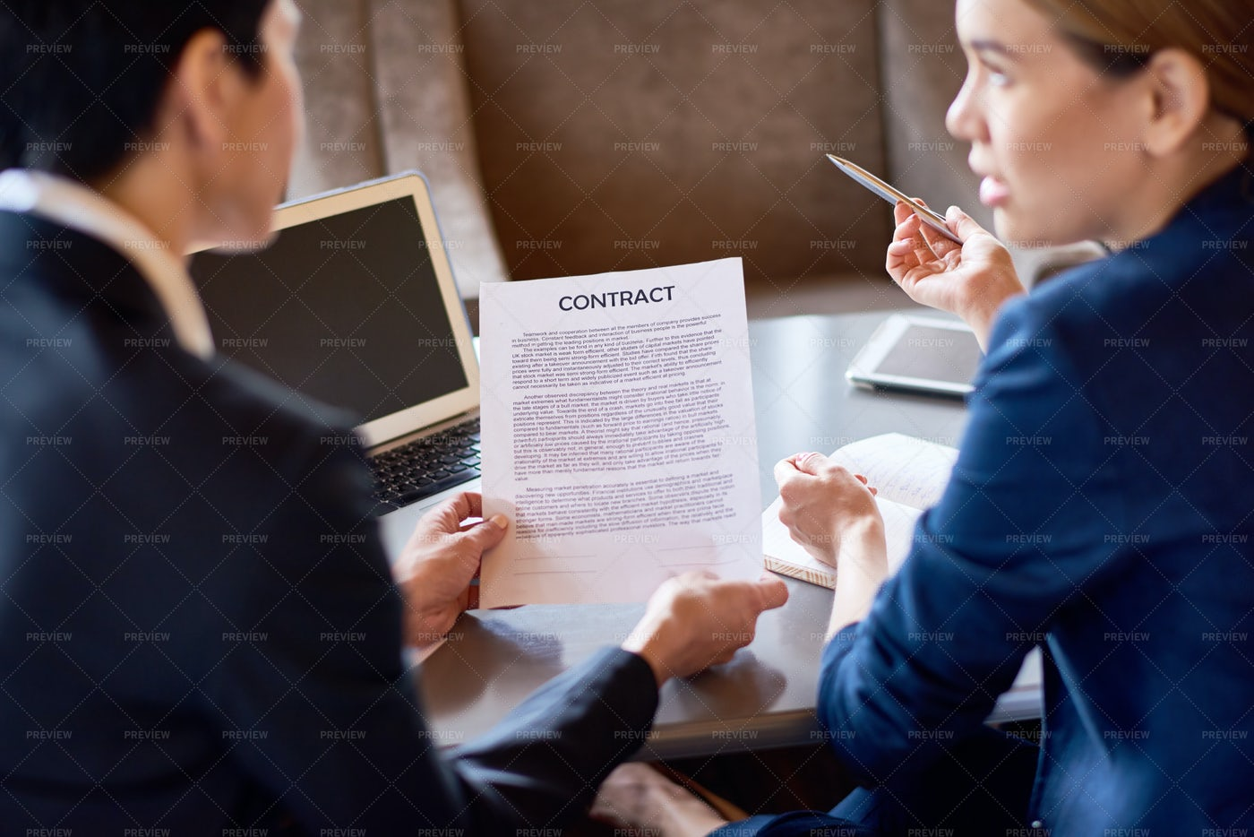 Discussing Terms Of Agreement: Stock Photos